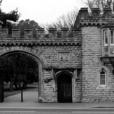 Old blak and white photo of the West Lodge and Gate