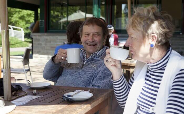 Elderly couple drinking tea in the sunshine